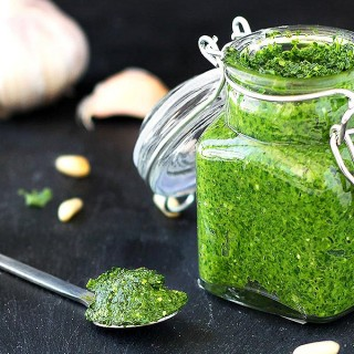 Kale Pesto Recipe - easy, healthy, and delicious! Spread it on sandwiches, serve it with chicken or fish, use it as a pasta or pizza sauce. Make it vegan and paleo by leaving out the parmesan cheese.