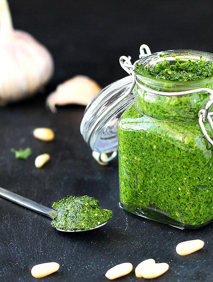 Kale Pesto is a variation of the classic basil pesto. Spread it on sandwiches, serve it with chicken or fish, use it as a pasta sauce. Make it vegan and paleo by leaving out the parmesan cheese.