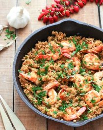 garlic shrimp and quinoa in a cast iron pan