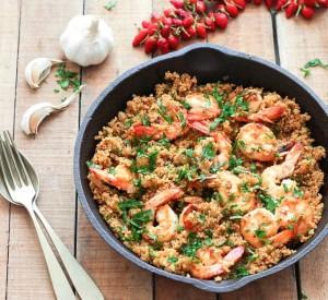 garlic shrimp and quinoa in a cast iron pan
