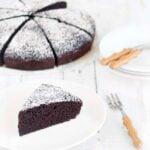eggless chocolate cake and a slice on a plate