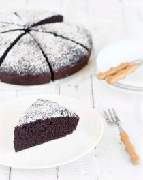 eggless chocolate cake and a slice on a plate