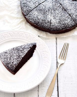eggless chocolate cake and a slice on a plate. Top view