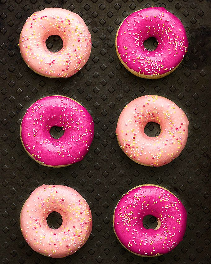 Vanilla Glazed Baked Donuts: soft and delicious baked donuts, dipped in a thick vanilla glaze and topped with sprinkles. Only 189 calories per donut!