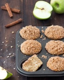 Soft, fluffy, and bursting with flavor, these cinnamon apple crumb muffins are delicious for breakfast or as snack. They are studded with apple pieces, spiked with cinnamon and have a crunchy crumb topping.