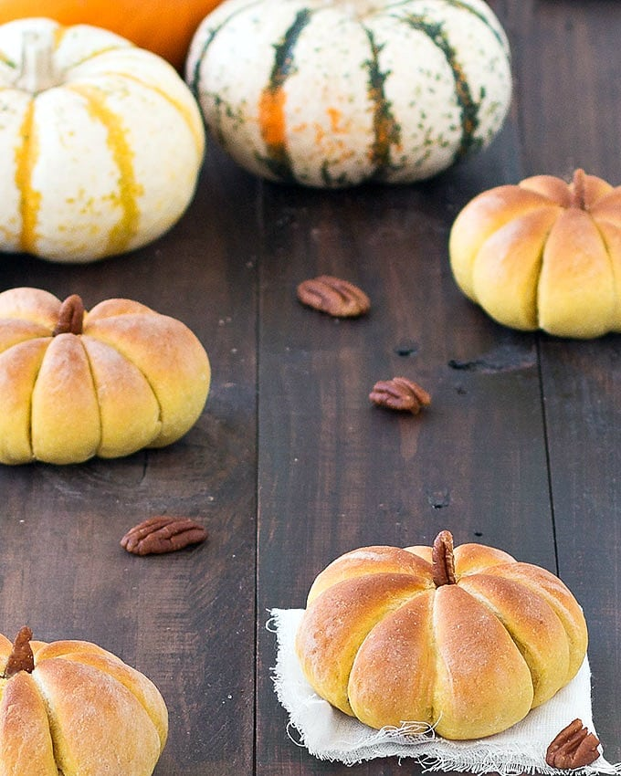 These pumpkin dinner rolls will be a hit at your Thanksgiving or Halloween dinner table with their adorable pumpkin shapes.