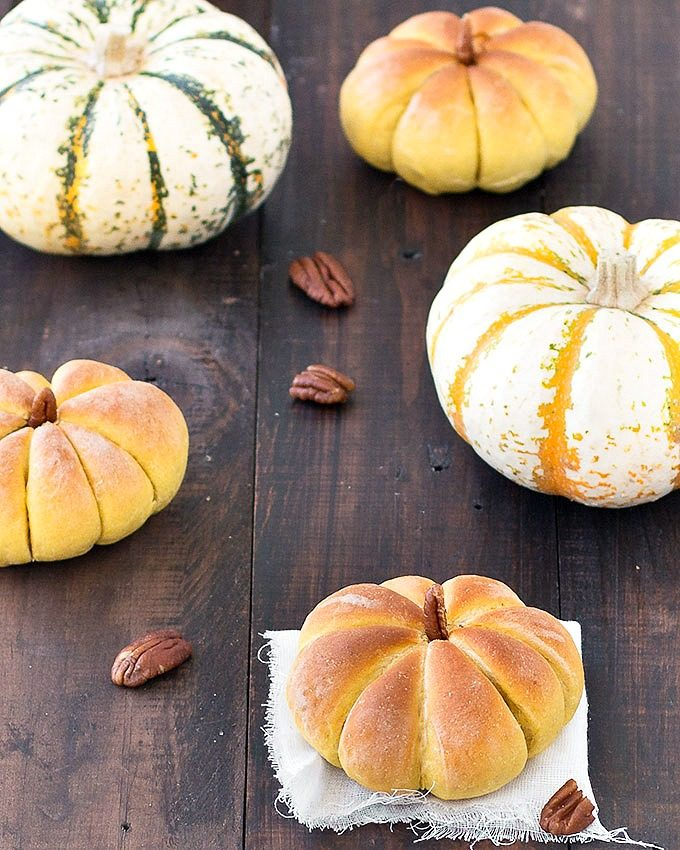 These pumpkin dinner rolls will be a hit at your Thanksgiving or Halloween dinner table with their adorable pumpkin shapes. Vegan-vegetarian