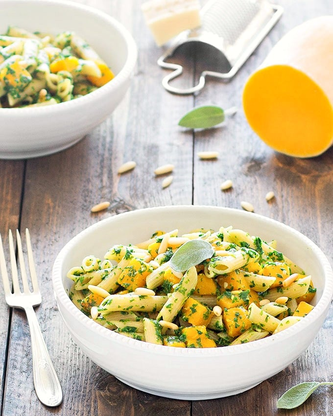 pasta with butternut squash and kale pesto - Pasta tossed with kale pesto, roasted butternut squash, and pine nuts. This recipe is super easy and full of flavor!