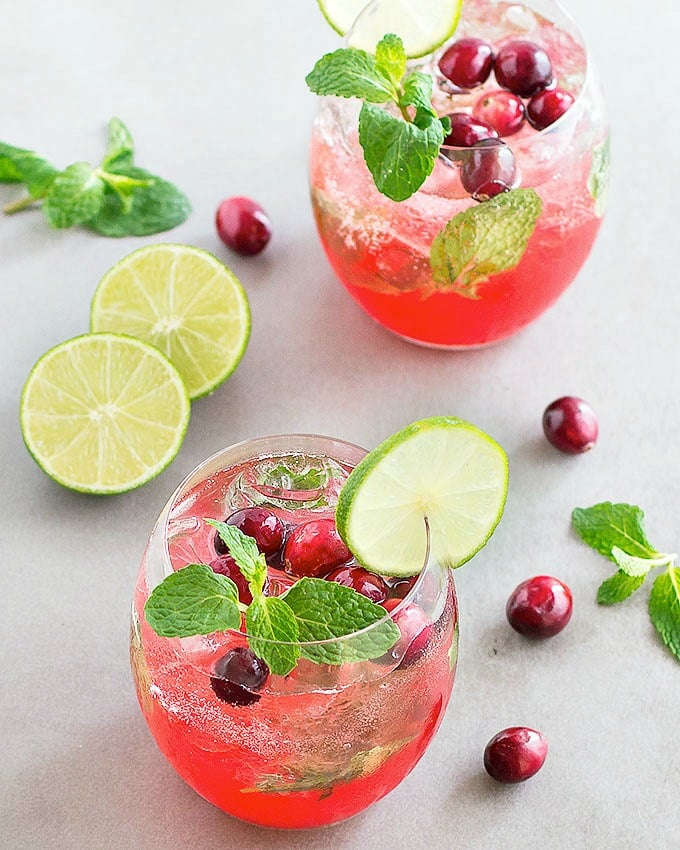 Entertain your guests with this beautiful holiday cranberry mojito. It ...