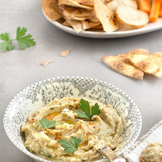 Artichoke and White Bean Dip - an easy, delicious, and healthy appetizer or snack that you can whip up in the food processor in 5 minutes! Perfect served with pita chips, fresh veggies or crackers