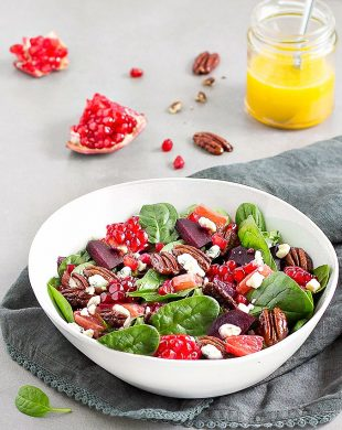 This spinach salad is filled with beetroots, pomegranate, crumbled gorgonzola cheese, grapefruit, and candied pecans. Tossed with a maple citrus vinaigrette, it's the perfect winter salad.