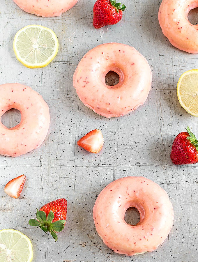 Treat yourself to these easy strawberry lemon baked donuts for breakfast! Soft, fresh and bright lemon donuts dipped in a thick strawberry glaze.