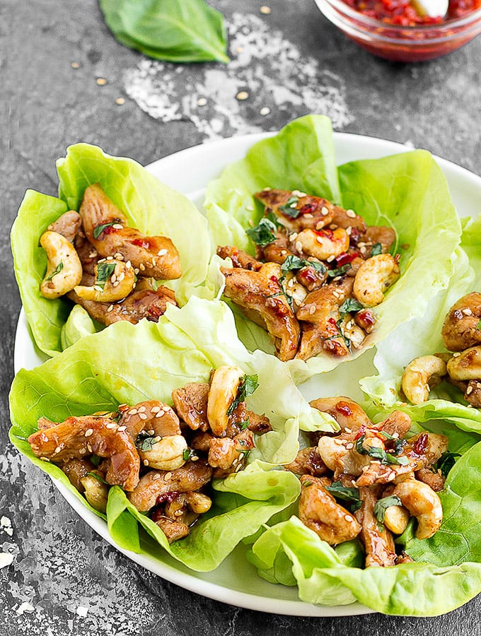 A white plate with five lettuce wraps - close up