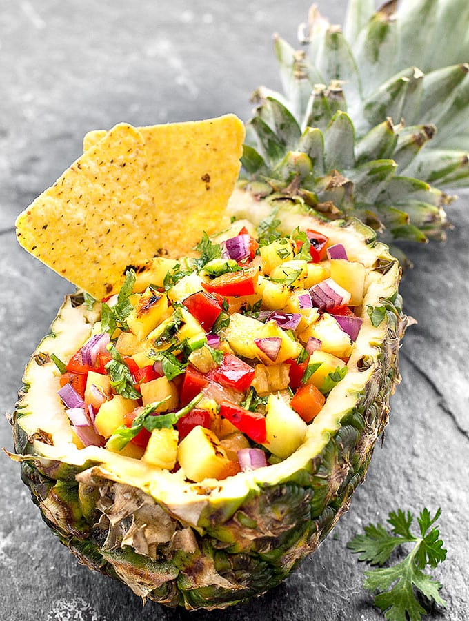 Tropical Grilled Pineapple Salsa - sweet, savory, crunchy, spicy and fresh. It's perfect with tortilla chips, tacos, grilled chicken, fish, or shrimp.