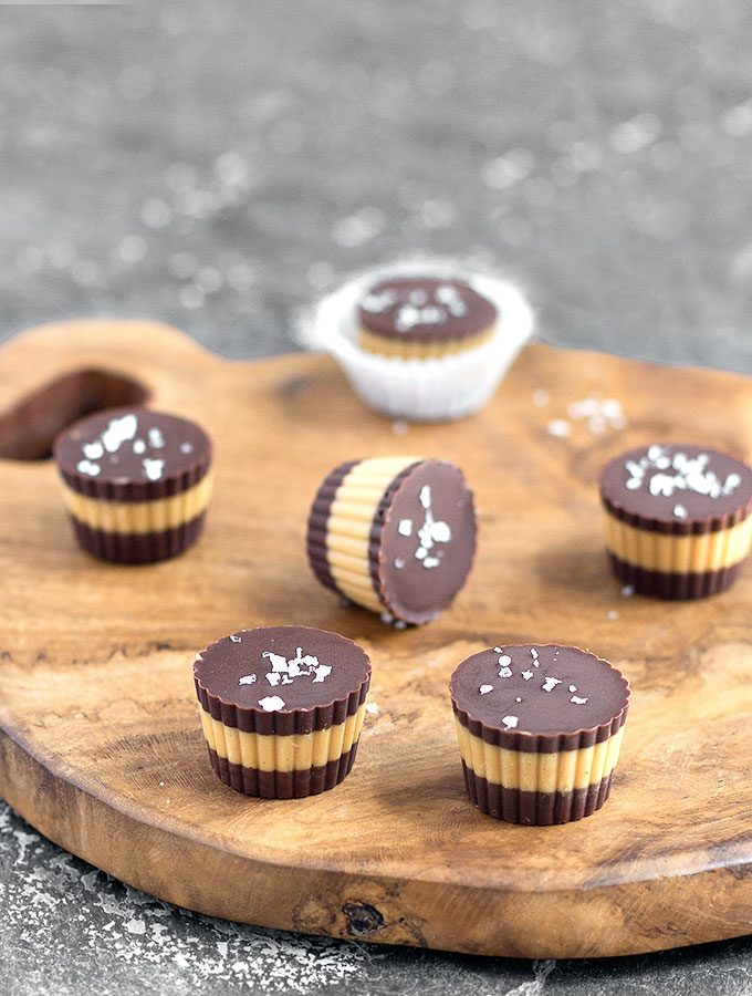 salted chocolate peanut butter cups on a wooden board