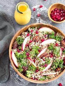 Apple Kale Quinoa Salad with Pumpkin Turmeric Dressing - An easy, healthy, and nutritious fall/autumn salad.