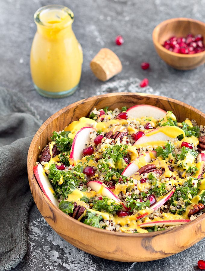 Apple Kale Quinoa Salad with Pumpkin Turmeric Dressing - An easy, healthy, and nutritious fall/autumn salad.