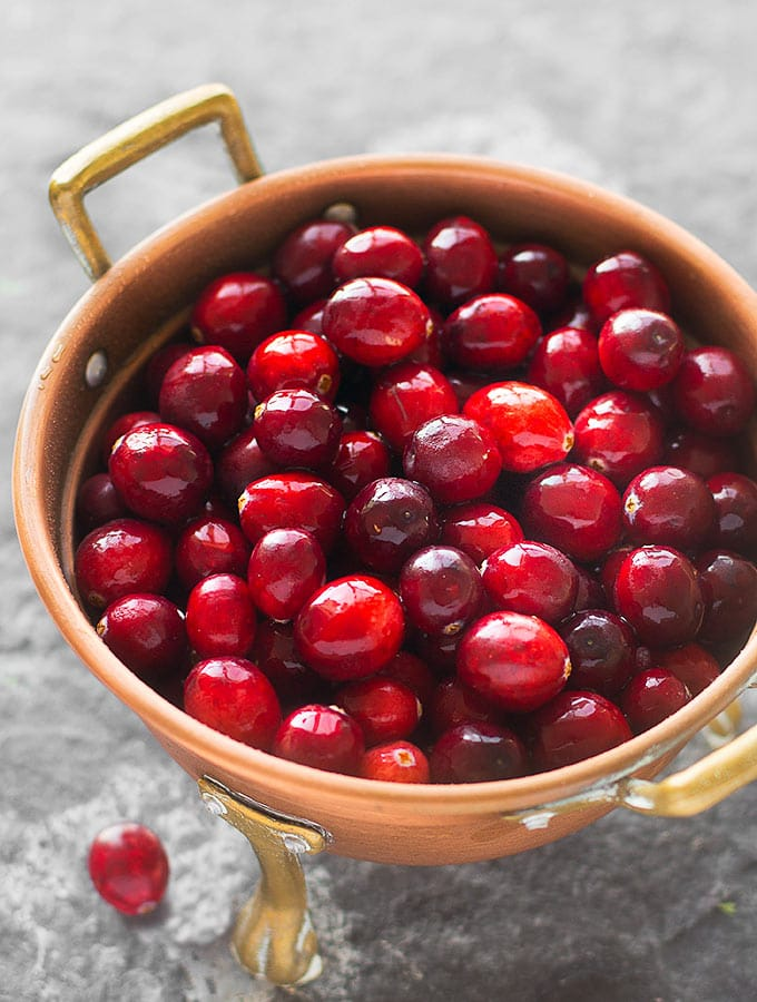 Skip the canned cranberry sauce this Thanksgiving and try my homemade lemongrass cranberry sauce. It's tart, sweet, and infused with orange, cinnamon and lemongrass.