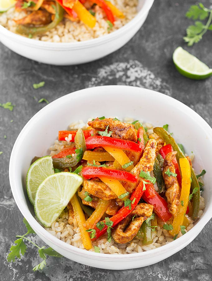 Sheet Pan Chicken Fajita Rice Bowls- A quick, simple and packed with flavor weeknight dinner that makes great leftovers! Step by step recipe, chicken, cilantro, lime