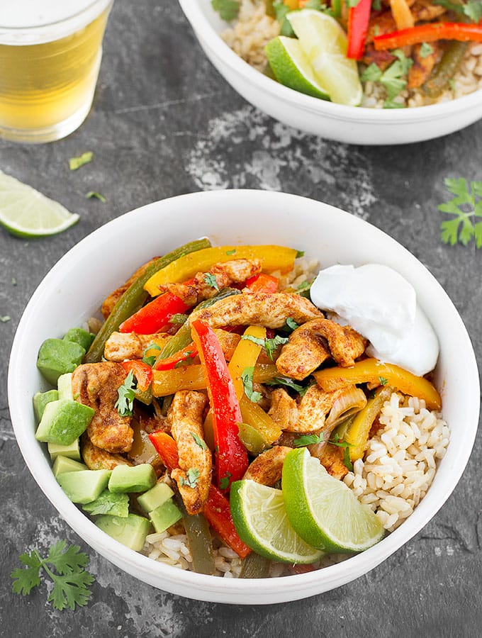 Sheet Pan Chicken Fajita Rice Bowls- A quick, simple and packed with flavor weeknight dinner that makes great leftovers!