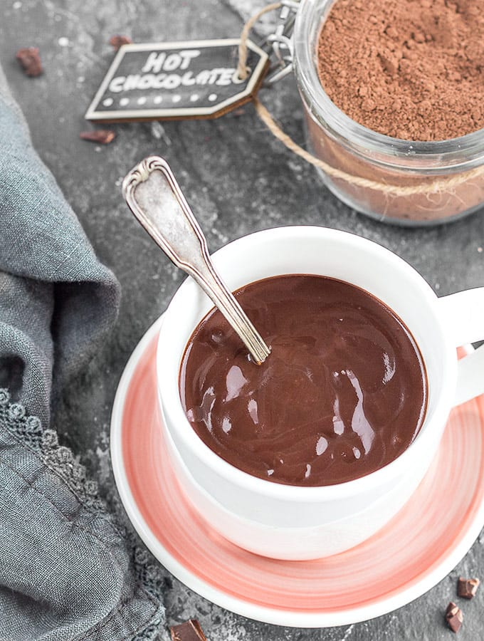 A mug of hot chocolate with a spoon