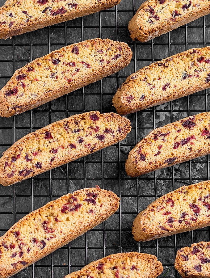 These crunchy Cranberry Orange Biscotti drizzled with white chocolate make a delightful and delicious holiday gift! As Easy As Apple Pie's easy seasonal recipe.