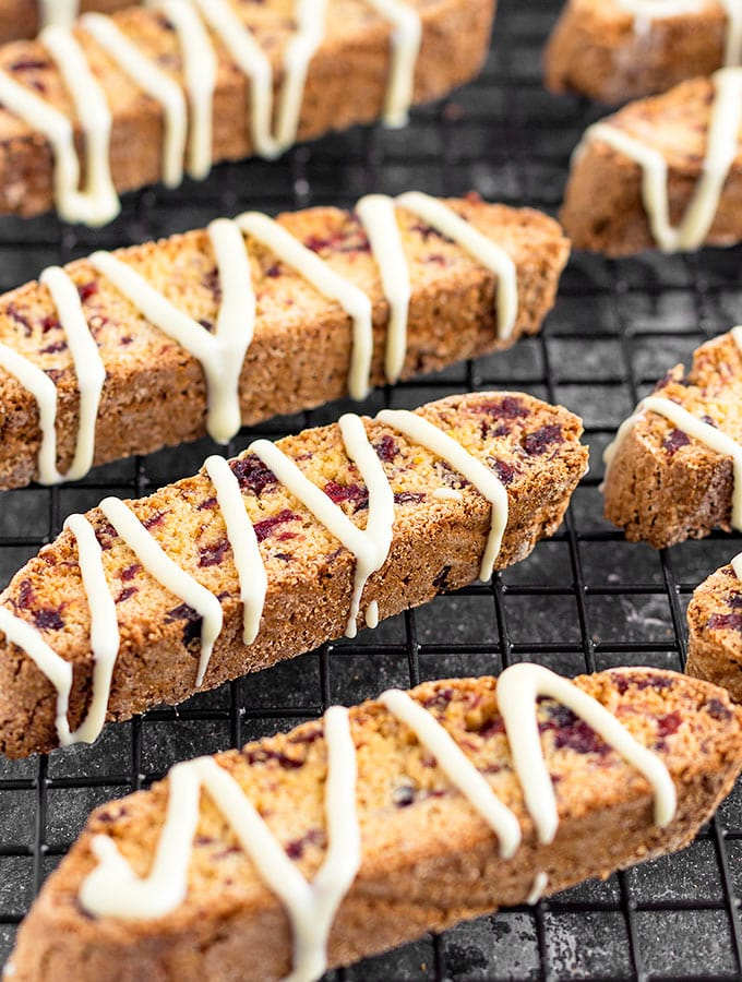 These crunchy Cranberry Orange Biscotti drizzled with white chocolate make a delightful and delicious holiday gift! As Easy As Apple Pie biscotti recipe.
