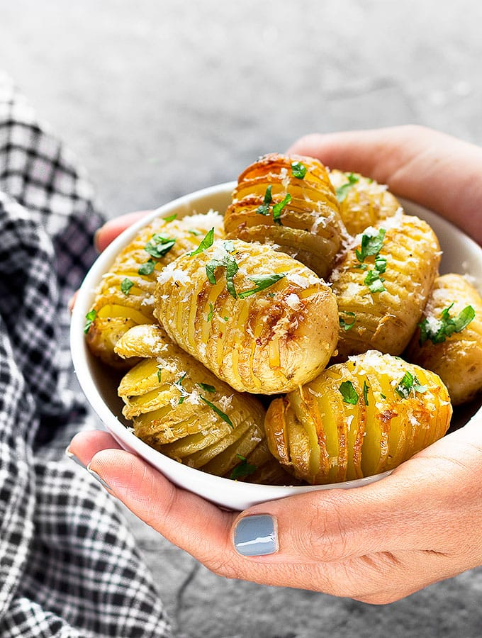 A delicious bowl of Garlic Parmesan Mini Hasselback Potatoes - a simple and elegant side dish or appetizer that will impress your guests! | aseasyasapplepie.com