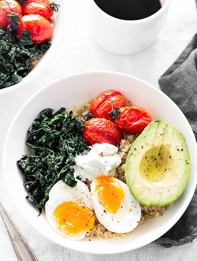 Two savory quinoa breakfast bowls and a cup of coffee