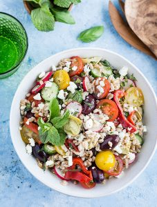 Mediterranean Farro Salad - This quick but impressive dish is perfect for summer picnics, barbecues or anytime you need an easy, delicious, and healthy weeknight dinner! Recipe at aseasyasapplepie.com