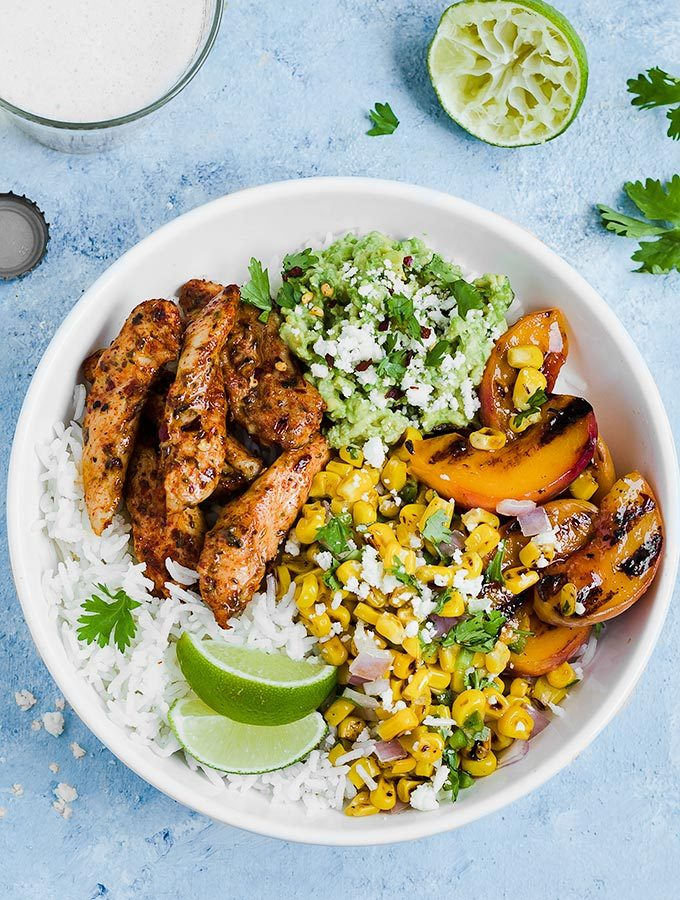 Chicken Taco Bowls with Grilled Peaches and Corn Salsa – an easy recipe ready in 35 minutes. Perfect for meal prep, make ahead lunches, or weeknight dinners