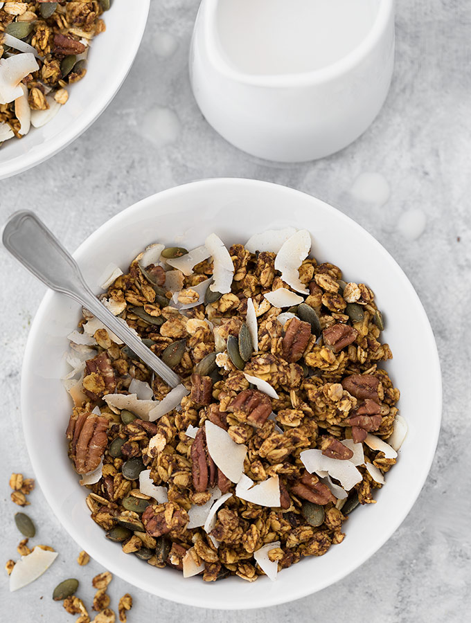 Pumpkin Spice Granola makes the perfect healthy breakfast.Best of all, this easy granola recipe is vegan and refined sugar free. Recipe at aseasyasapplepie.com