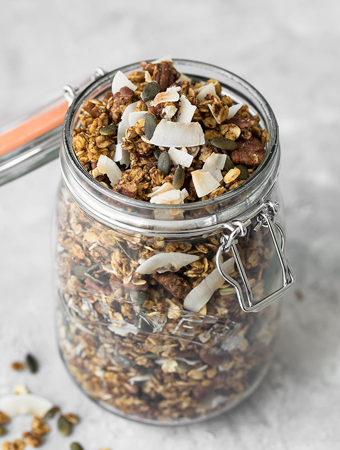 Pumpkin Spice Granola - A simple, healthy granola infused with tons of pumpkin flavor and warm fall spices! Recipe at aseasyasapplepie.com