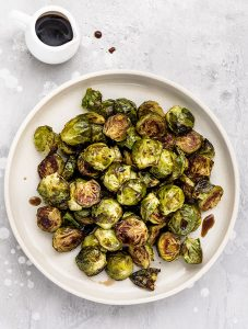 Roasted Balsamic Brussels Sprouts - Brussels sprouts roasted in the oven until perfectly crisp and caramelized, then drizzled with a touch of balsamic vinegar and honeyjust before serving. A quick, easy and healthy side dish perfect for your Thanksgiving or Christmas table!