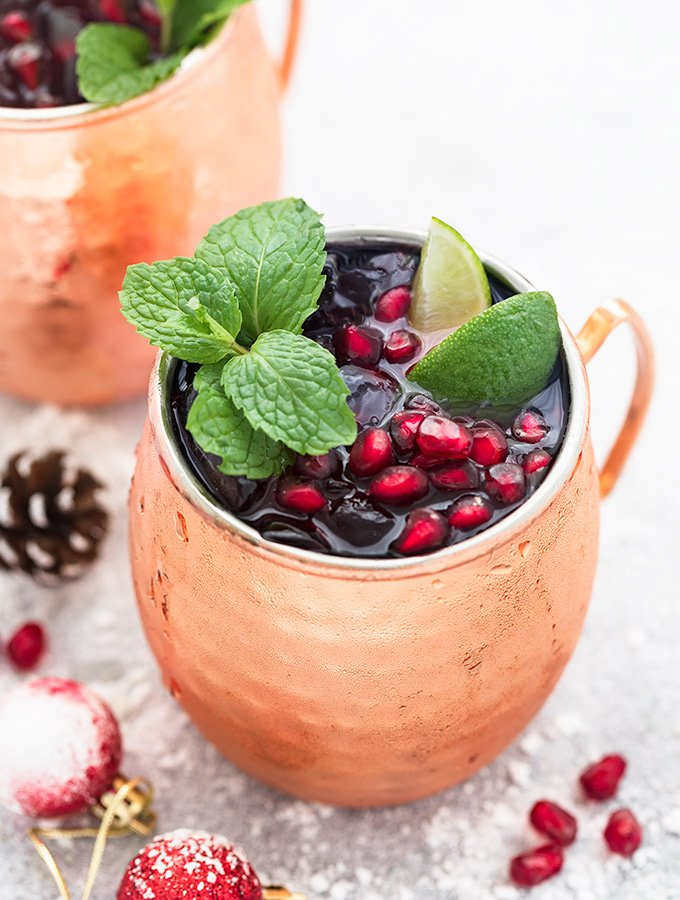 Two mugs of Pomegranate Moscow mule
