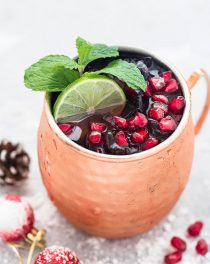 A festive twist on the classic Moscow Mule. Freshly squeezed lime juice, vodka, ginger beer, and a touch of pomegranate juice, make this Pomegranate Moscow Mule the perfect holiday cocktail!