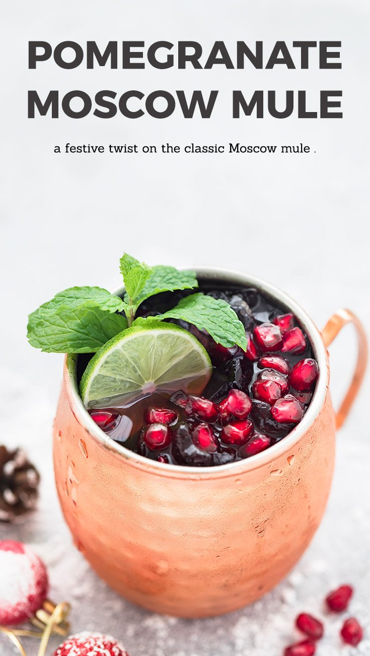 A festive twist on the classic Moscow Mule. Freshly squeezed lime juice, vodka, ginger beer, and a touch of pomegranate juice, make this Pomegranate Moscow Mule the perfect holiday cocktail! #moscowmule #cocktail #holidays #christmas #gingerbeer #pomegranate #festive #drink