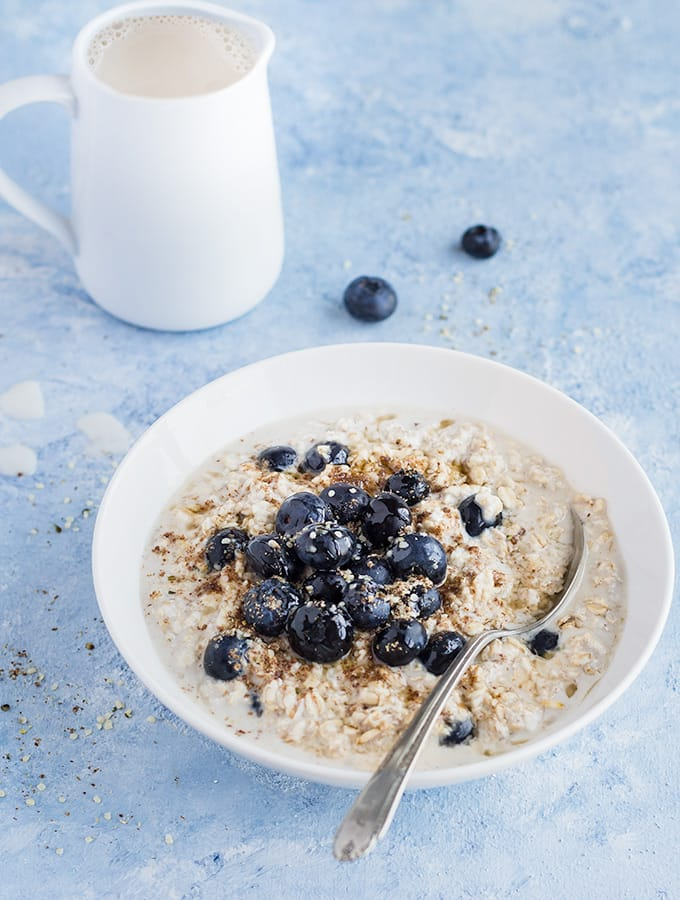 bowl of overnight oats topped with fresh blueberries
