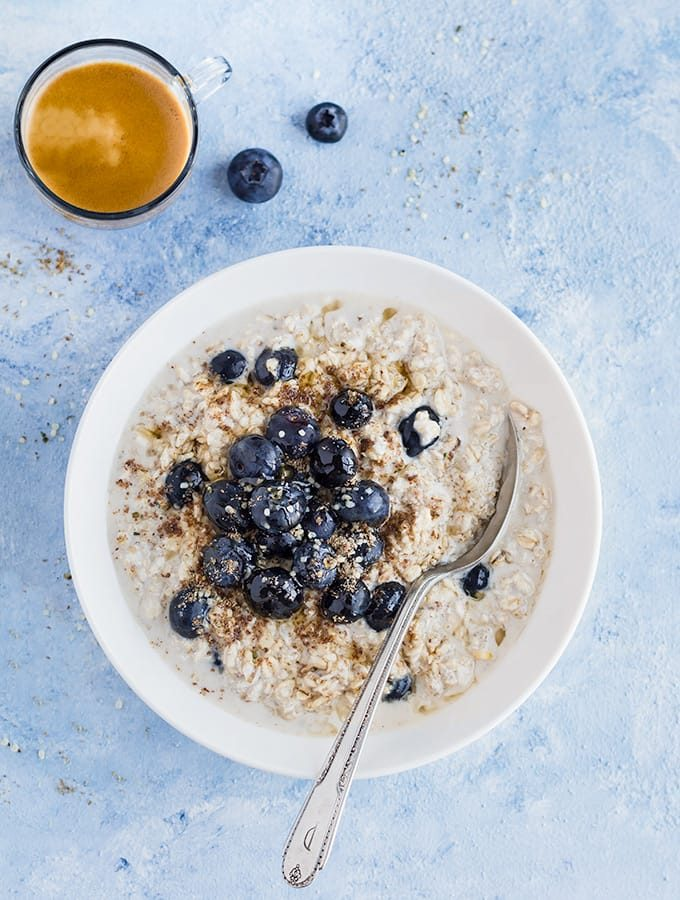 bowl of blueberry overnight oats and a cup of coffee