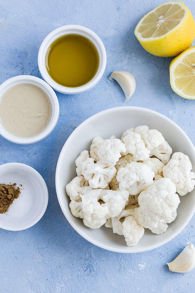 Ingredients for cauliflower hummus in bowls